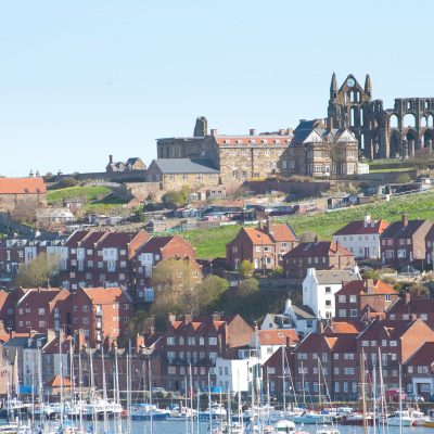 Scenic fishing Port and abbey ruins in Whitby, North Yorkshire